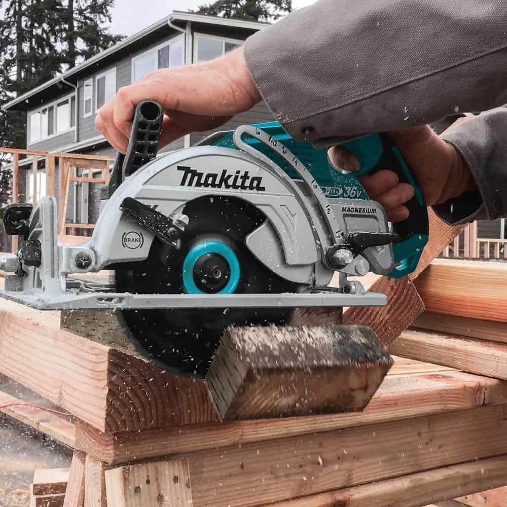 2 battery cordless circular saw cutting wood
