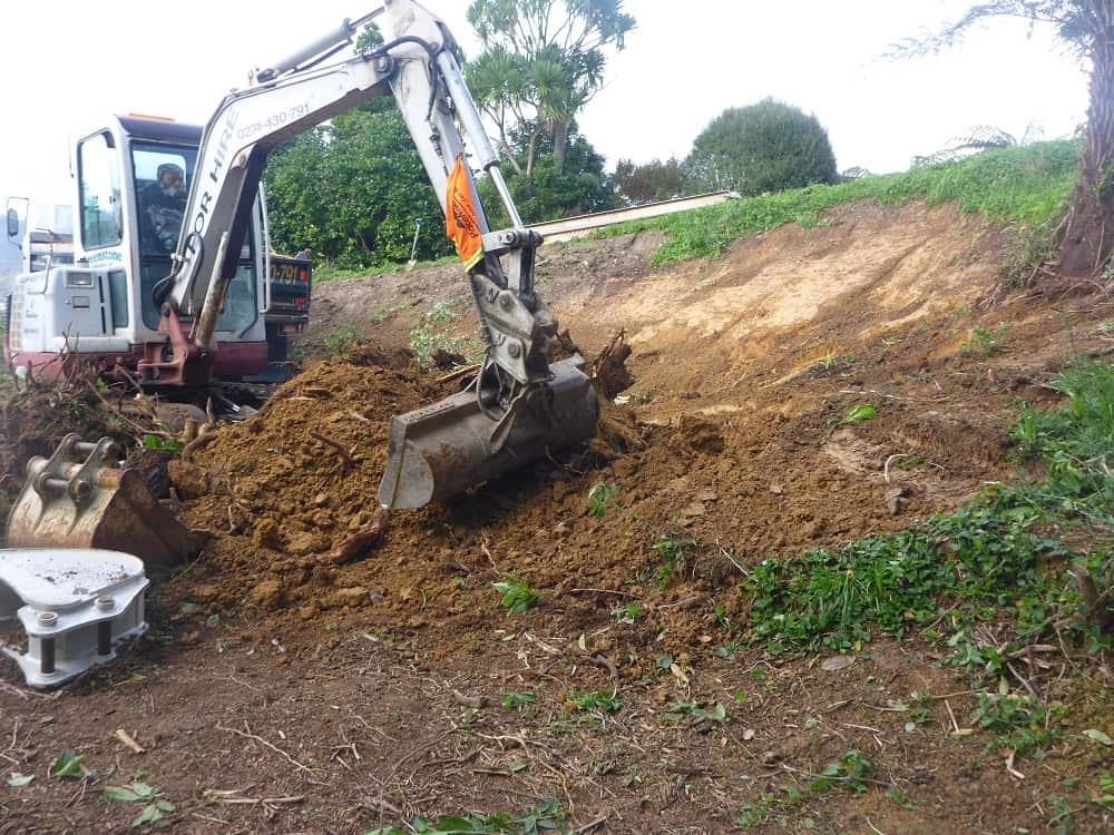 Digger digging yard flat