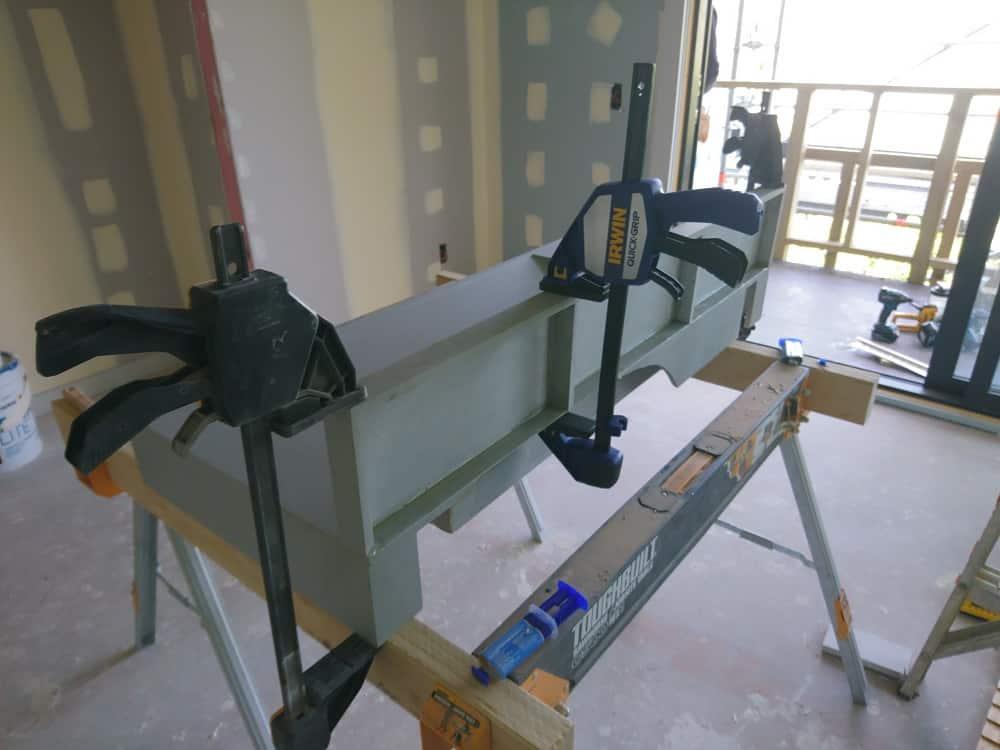 Glueing vanity using wood clamps