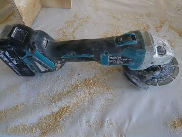 makita cordless angle grinder on site