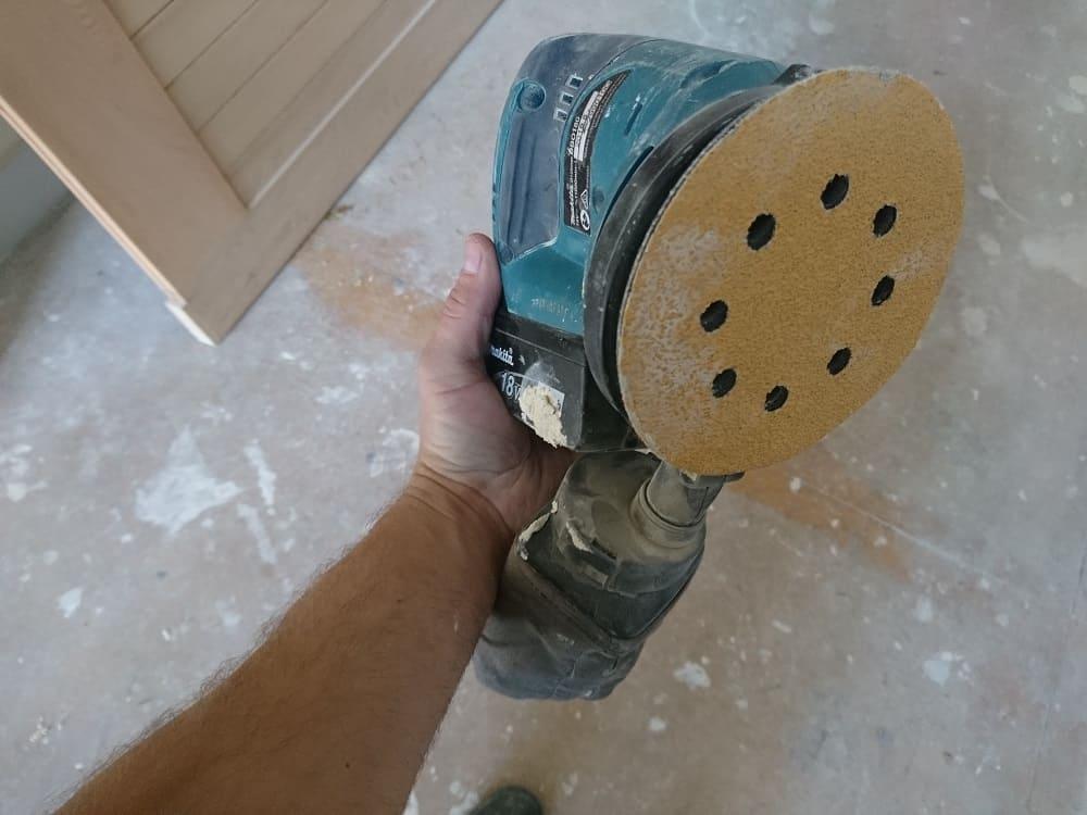 Sanding paper on palm sander