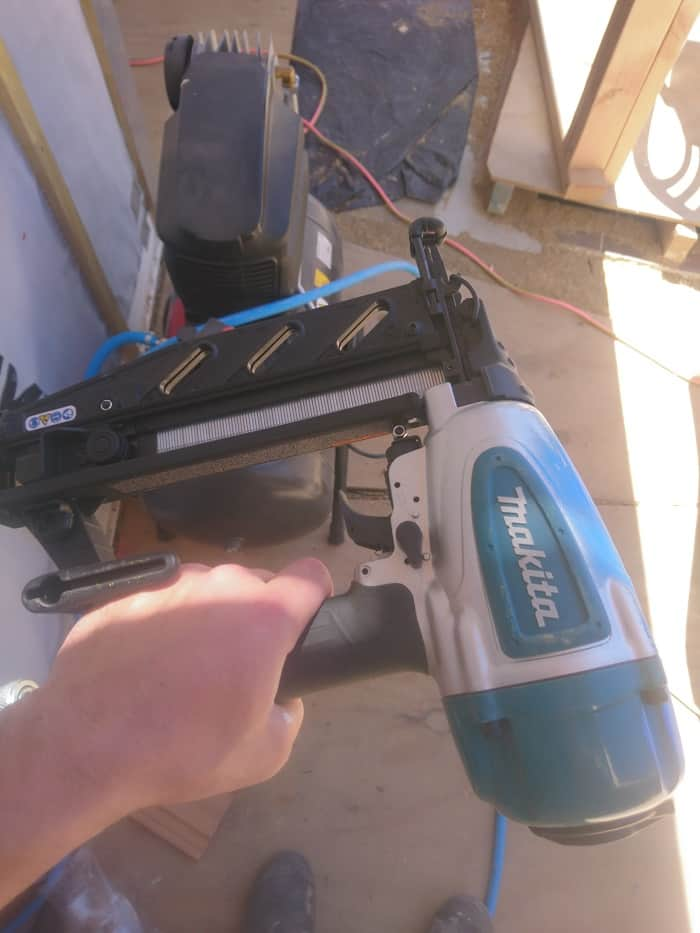 Me Holding Makita Air Bradder
