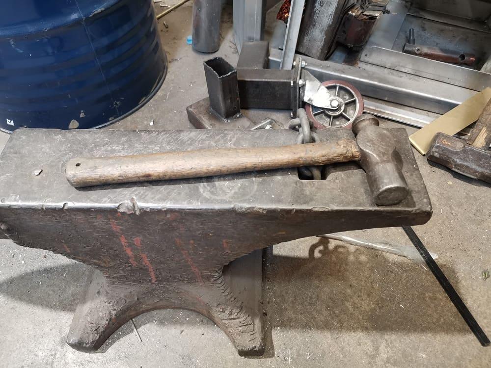 Ball peen hammer on steel bench