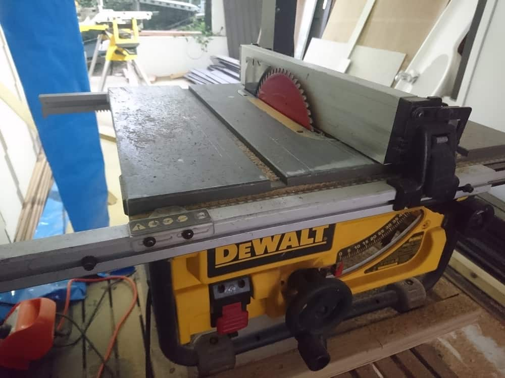 Aaron using a Dewalt portable table saw