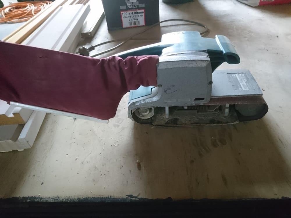 Aaron using a Makita belt sander