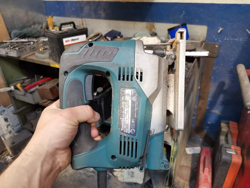 Aaron using a Makita cordless jigsaw tool
