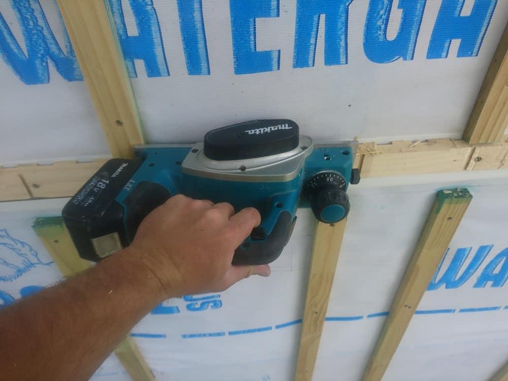 Aaron using a Makita cordless wood planer