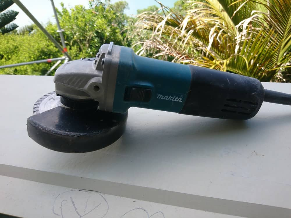 Aaron using a corded Makita 4 5 inch angle grinder