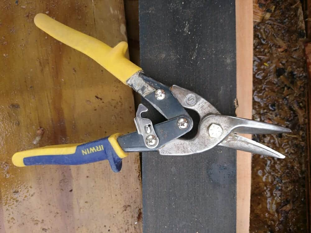 Cutting flashing with tin snips