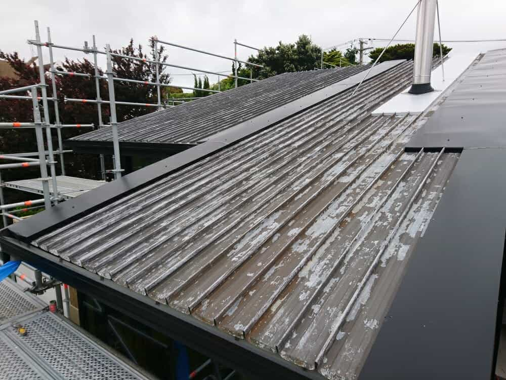 Old roof being repaired