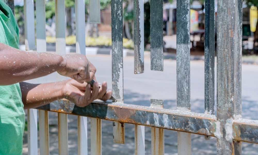Removing paint from fence