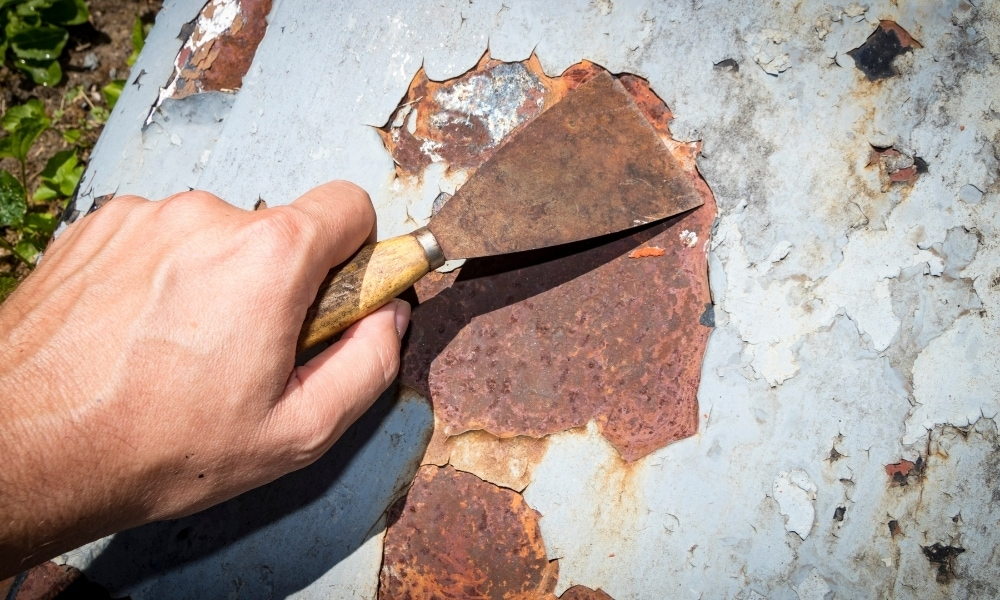 Scraping off paint on metal