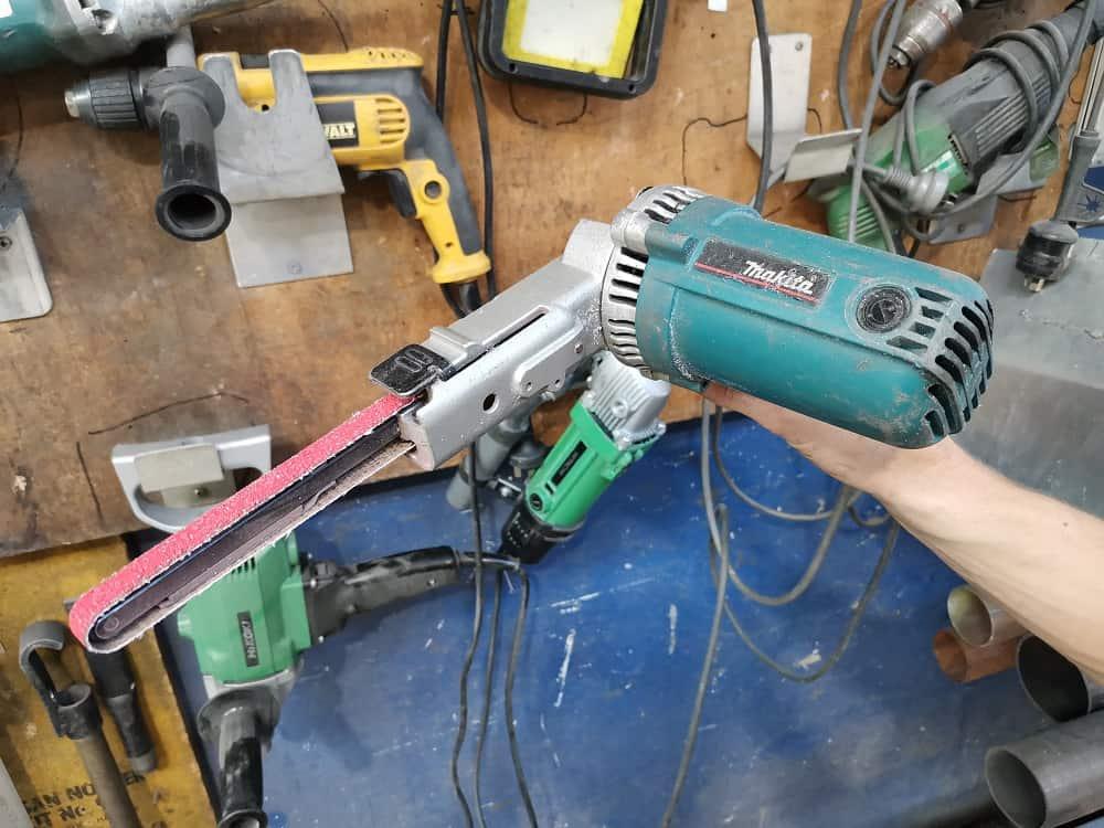 Makita file belt sander in workshop