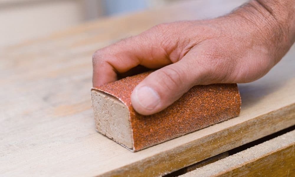 Sanding wood by hand with a block