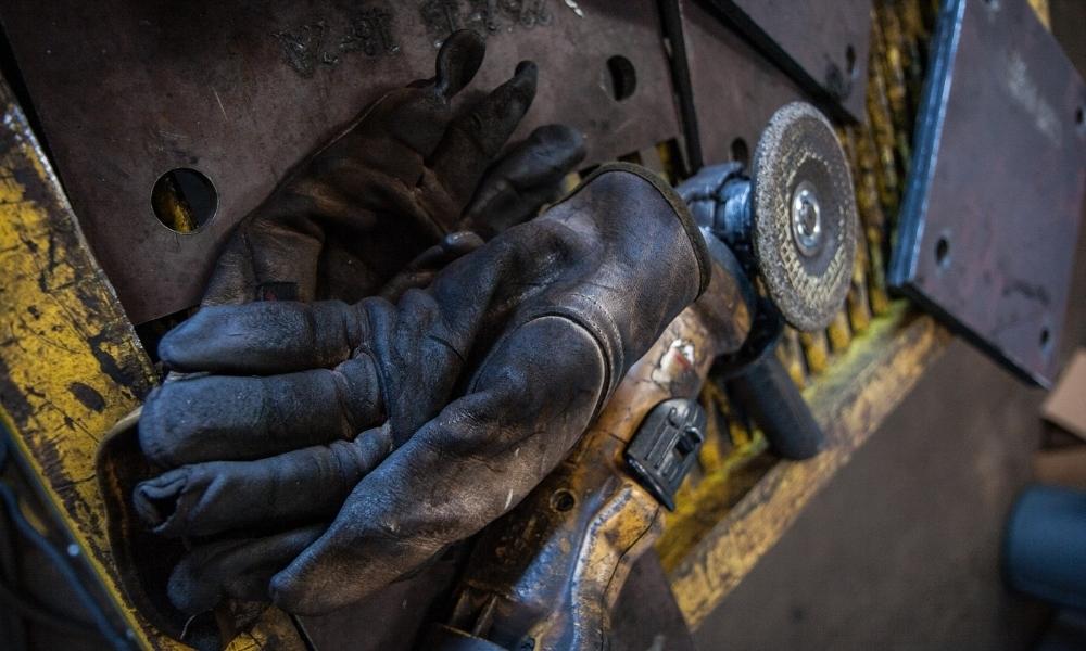 Safety gloves on workstation