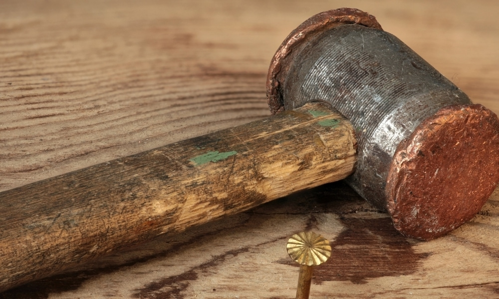 Copper and hide hammer