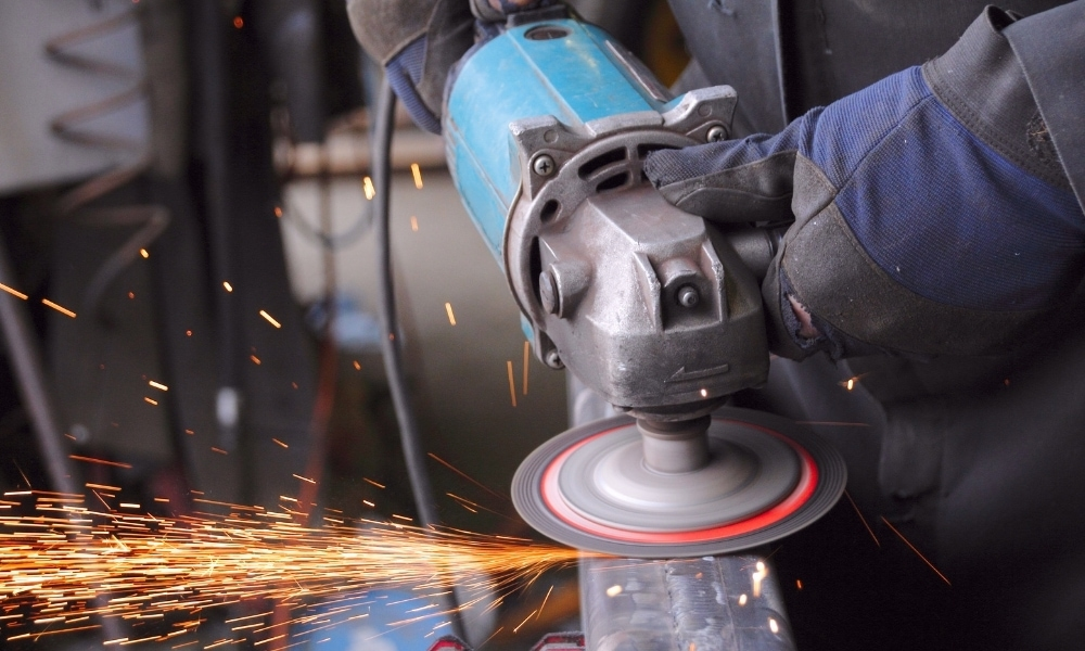 Using an angle grinder to sand weld