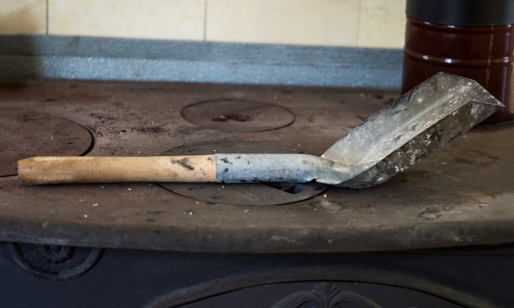 A fireplace shovel used on top of a stove