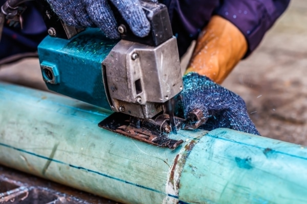 Cutting a PVC pipe with a jigsaw
