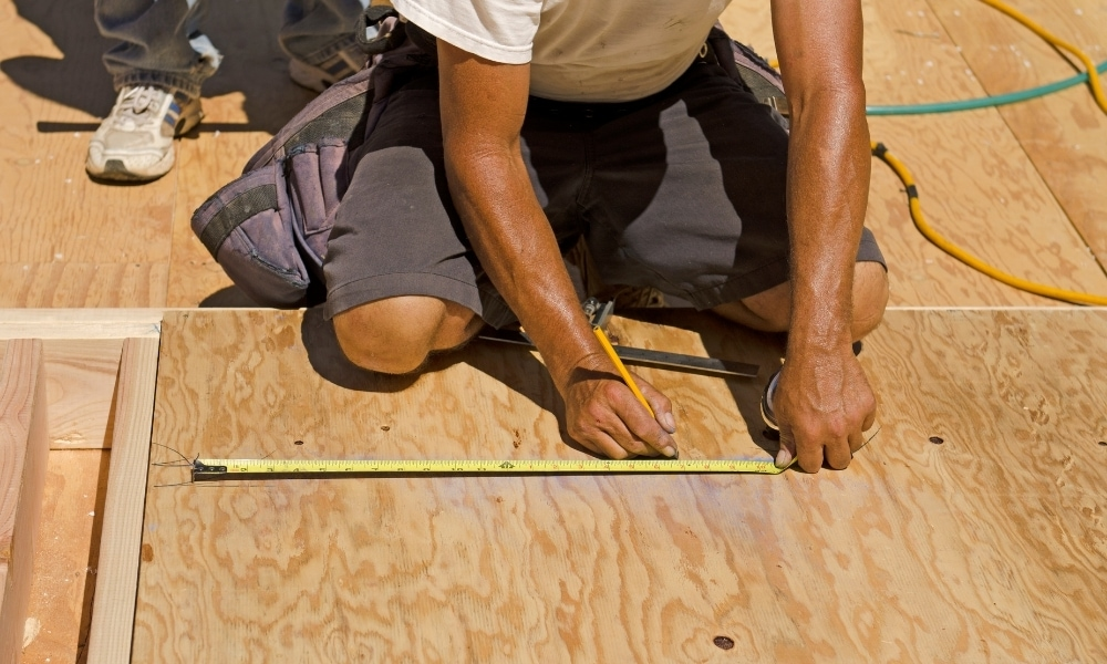 Marking wall studs with a tape measure