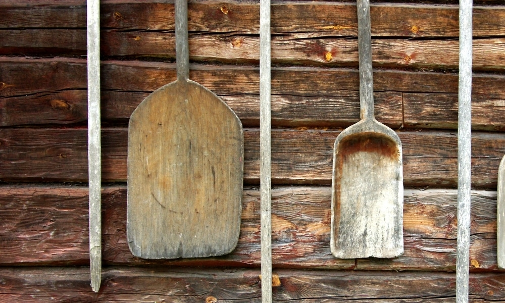 Old wooden shovel hanging on the wall