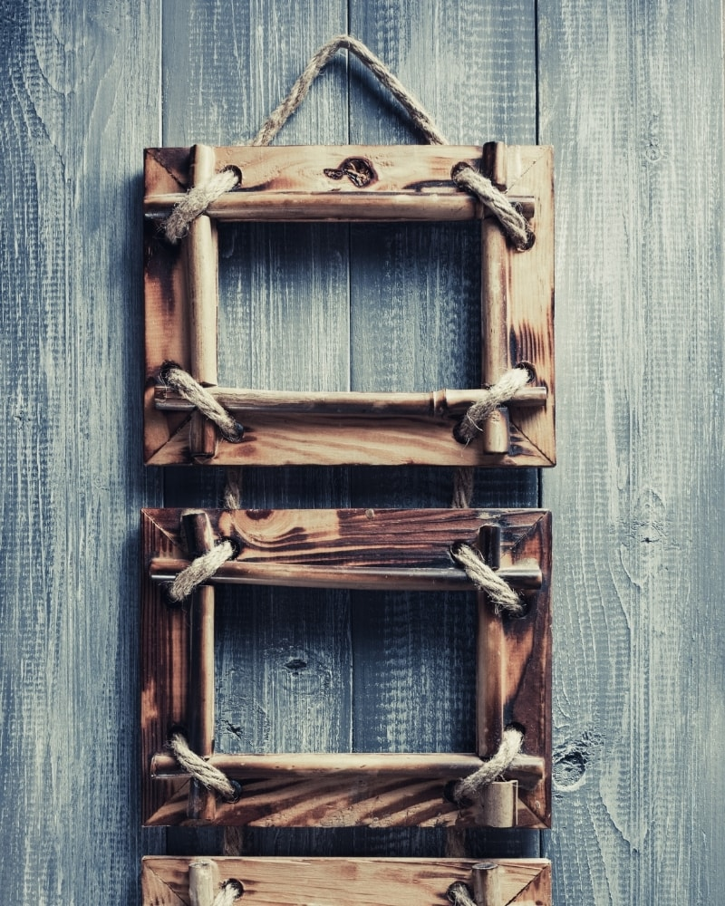 Wooden art frame with stylish hanging strings