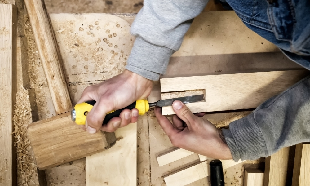 An attempt to cut groove using a chisel