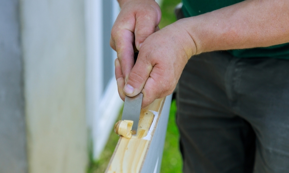 Cutting a door hinge with a chisel