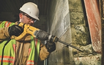 Dewalt D25263K rotary hammer drilling into brick and concrete