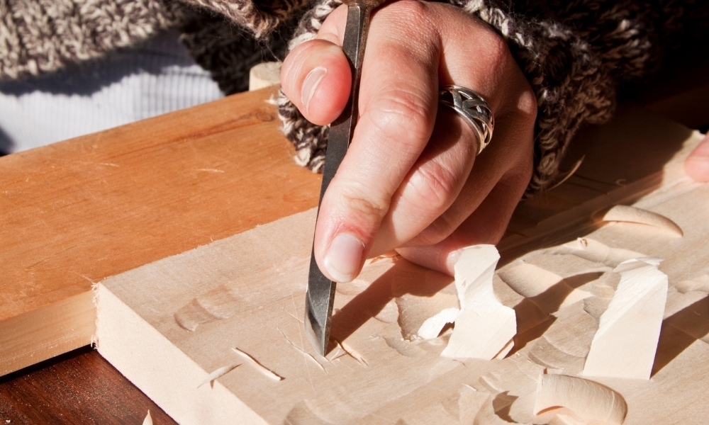 Skewed chisel carving on a small wood slab