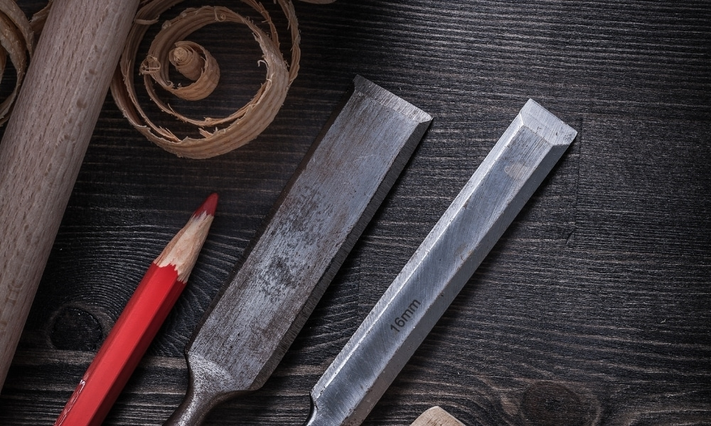 Two pieces of firmer chisels with a red pencil marker