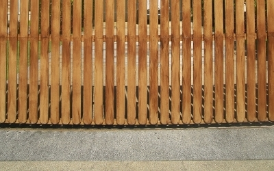 Wood fence constructed above a concrete floor
